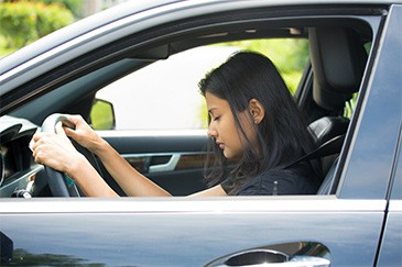 Photo of Narcoleptic woman on the steering wheel